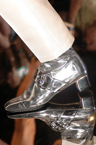 Romy silver booties by Gucci